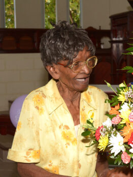 CENTENARIAN Ernesta Smith sharing a joking with Calvin Watson, who presented her with a bouquet at the Whitehall Methodist Church. (Picture by Christoff Griffith)